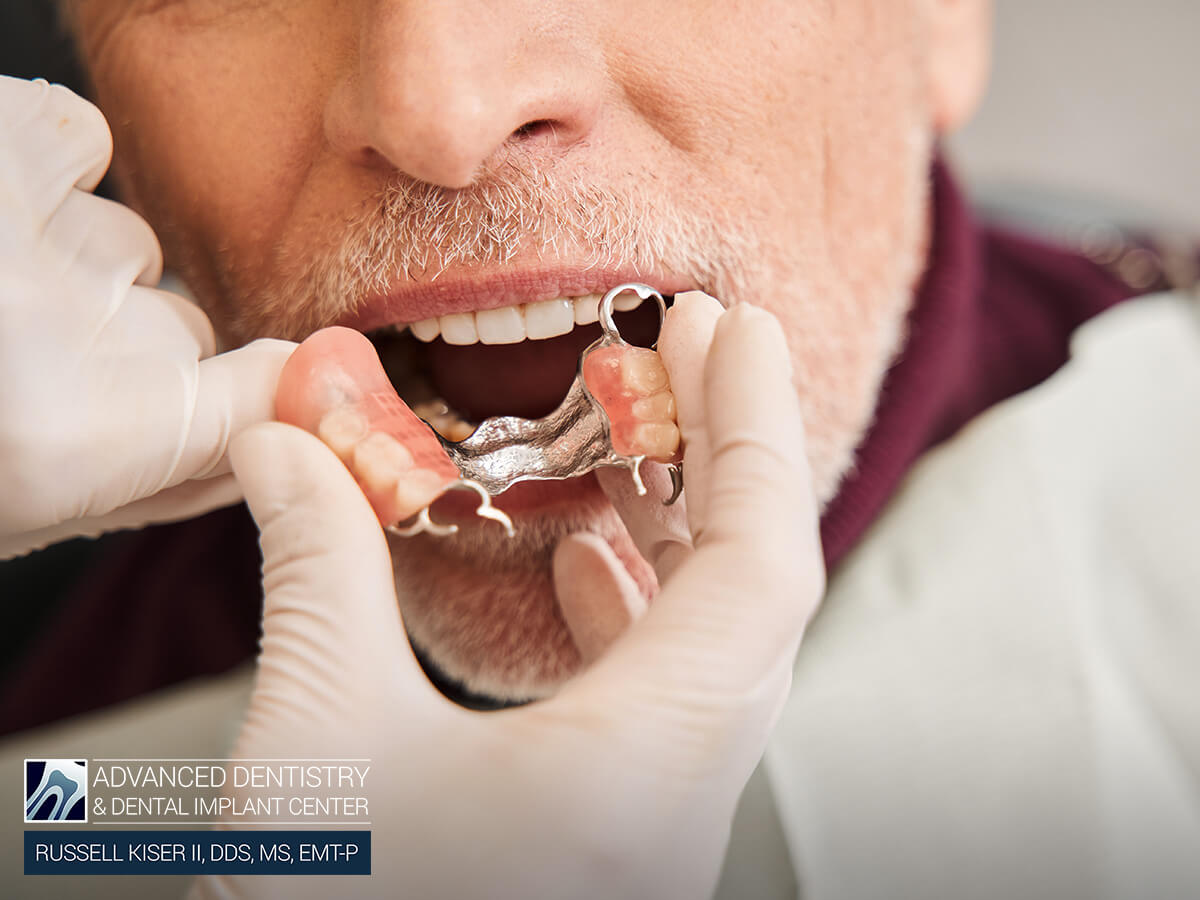 Professional Dentist Applying A Patient's Partial Denture In Mansfield, OH